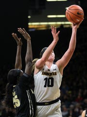 Iowa's Megan Gustafson takes a shot in the final seconds of the first half of the Hawkeyes' game against Purdue at Carver-Hawkeye Arena on Saturday, Jan. 13, 2018.