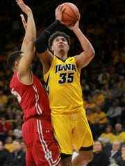 Iowa's Cordell Pemsl puts up a shot during the Hawkeyes'