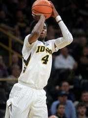 Iowa's Isaiah Moss shoots a 3-pointer during the Hawkeyes'