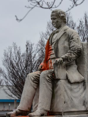 The statue of George Dennison Prentice, at the main branch of the Louisville Free Public Library, was hit by vandalism overnight. A glass container filled with orange paint was thrown on the controversial statue. Feb. 7, 2018