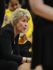 Iowa head coach Lisa Bluder talks to her team during