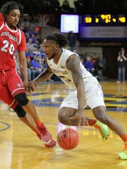 South Dakota State's David Jenkins, Jr. (5) drives