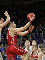 South Dakota's Matt Mooney scores on a layup during