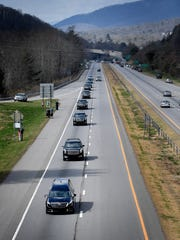 The motorcade carrying the body of the Rev. Billy Graham