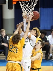 West High's Seybian Sims puts up a shot during the