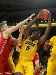 Iowa's Tyler Cook grabs a rebound during the Hawkeyes'
