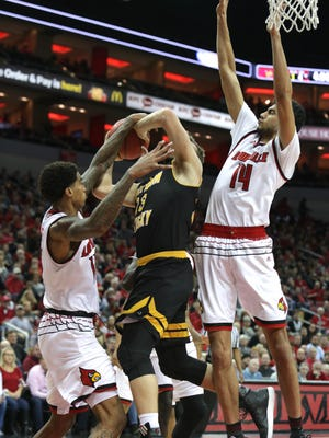 Louisville's Ray Spalding knocks the ball away from NKU's Carson Williams during NIT action. March 13, 2018