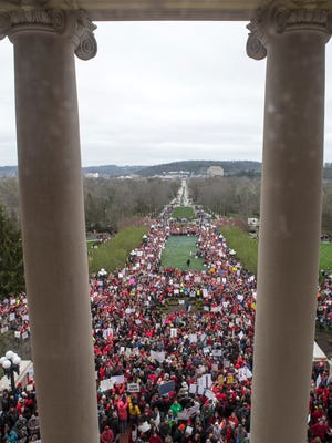 Thousands of Kentucky teachers and other state employees rallied at the State Capitol over recent changes that the state legislature made to their pensions. April 2, 2018.