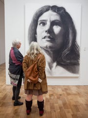 """Chuck Close's monumental portrait """"Nancy"""" is one of the centerpieces of the Milwaukee Art Museum's contemporary galleries. The museum plans to adjust wall text to indicate Close's role in discussions around gender inequity in the art world."""
