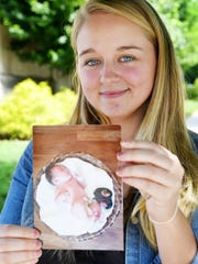 Kristin Ireland holds a photograph of her daughter, Lillian Taylor Drake, June 15, 2018.