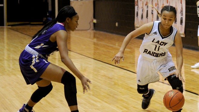 Rider's Tori Williamson dribbles while guarded by Denton's Vivica Hughes Tuesday, Jan. 31, 2017, at Rider. The Lady Raiders defeated the Lady Broncos 42-40.
