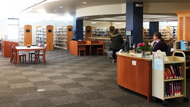 Installation of new carpeting at the Fond du Lac Public Library was an opportunity to make better use of the space and improve customer service. The Reference Desk is now located in the center of the second floor, where library staff is more accessible.