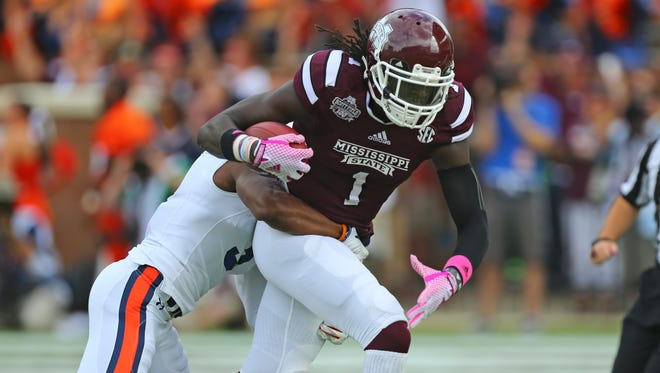 Mississippi State wide receiver De'Runnya Wilson (1) was arrested with friends Friday night in Alabama.