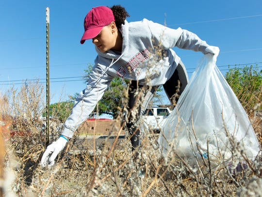 New Mexico State University student Kiki Shoemate, 21, picks up trash on Saturday, April 14, 2018 during the Great American Cleanup on Kansas Ave. behind the Mister Car Wash. The event was hosted by Parks & Recreation Department's Keep Las Cruces Beautiful and the New Mexico Clean and Beautiful programs.