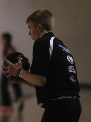 Jonathan Cummins of Simon Kenton gets set to throw the ball Feb. 13.