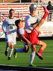 Canton senior forward Hunter Olson tries a spectacular