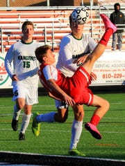Canton senior forward Hunter Olson tries a spectacular