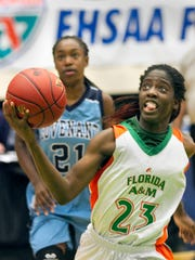 FAMU High School's Jazmine Jones (23) drives under the basket against Covenant Christian School during the second half of their FHSAA Girls 2-A Semifinal game at The Lakeland Center Tuesday. FAMU won the game 76-55. February 16, 2016 MICHAEL WILSON/THE LEDGER
