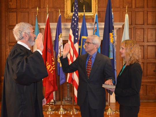 Mike Cooney, center, is sworn in Jan. 4, 2016, as the