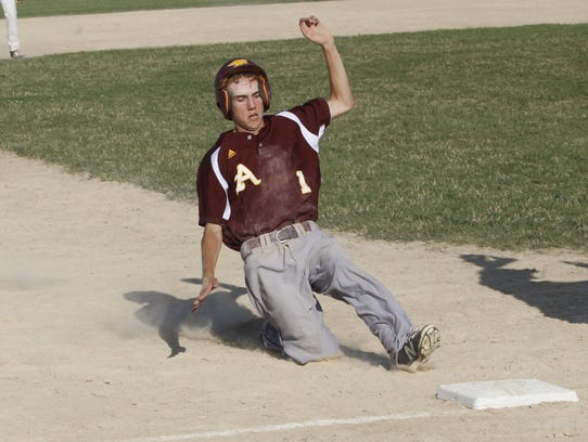 Ankeny runner Jake Slattery slides safely into third