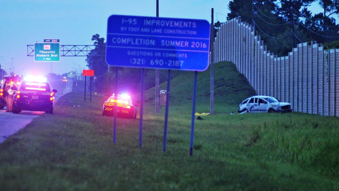 The scene of a crash involving multiple fatalities near Interstate 95 in Titusville on Monday, May 30, 2016.
