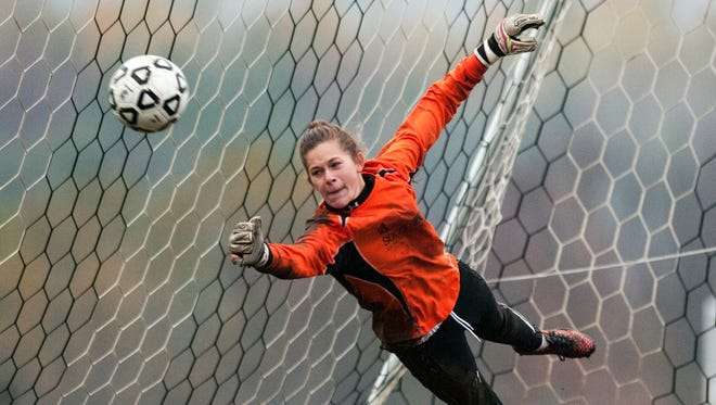 MMU goalie Emma Parent makes a save during penalty kicks to win the girls soccer playoff game between the Rice Green Knights and the Mount Mansfield Cougars at MMU High School on Tuesday afternoon October 21, 2014 in Jericho.