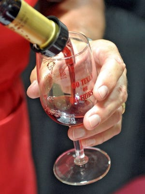 Times Record News file A volunteer pours a glass of Becker Vineyards' cabernet-Syrah at the Red River Wine & Beer Festival.