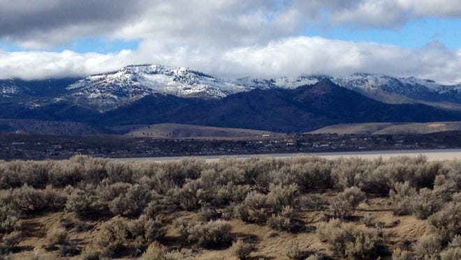A file photo of snow capped mountains near Reno. Local weather forecasters expect rain and snow to hit the Reno-Tahoe area Wednesday and early next week.