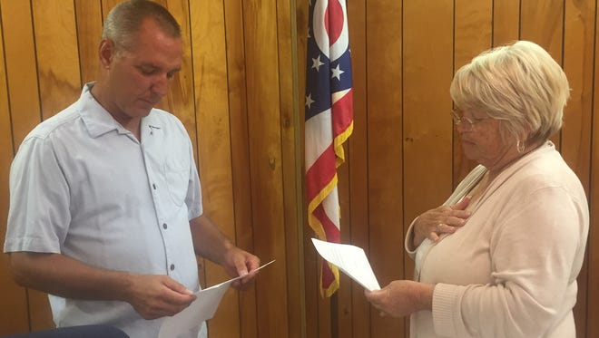 Trustee Charles Scott administers the oath of office to Fiscal Officer Carolyn Adams.
