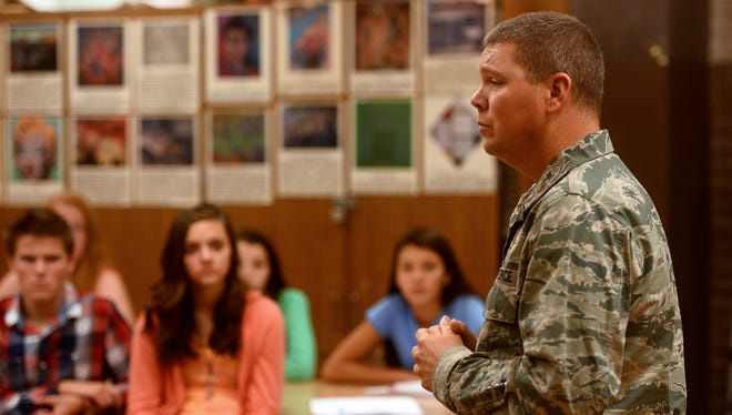 Major Cody Smith of the Montana Air National Guard presents during the United Way's eighth-grade career fair on Thursday at North Middle School.