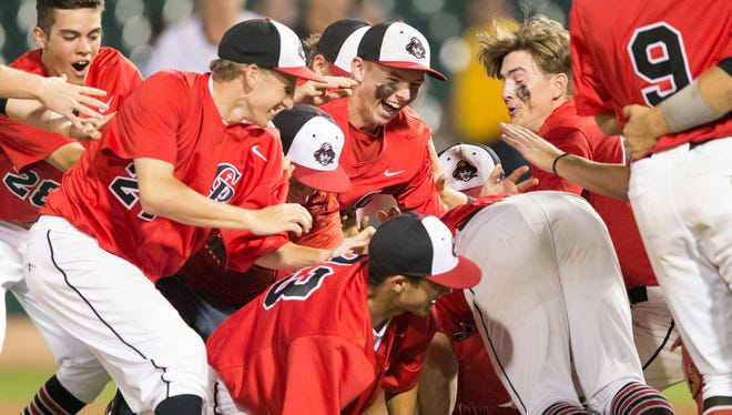 Cardinal Ritter High School players celebrate upon their victory over Wapihani High School, 2A baseball title game, Victory Field, Indianapolis, Friday, June 16, 2017. CRHS won 10-4.