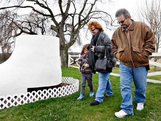 From left, Lydia Graeser, 6, and her grandparents Sylvia and John Beasley, all of Springettsbury Township, brace themselves against the cold breeze as they look around the outside of Haines Shoe House following a guided tour on the First Day of Spring in York, Sunday, March 20, 2016. The Shoe House will be open from First Day of Spring through Memorial Day: Fri, Sat, Sun 11-5. Visit the website at: www.hainesshoehouse.com for more information. Dawn J. Sagert photo