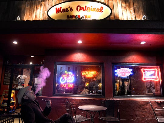 J.D. Wilkes takes a moment with his pipe outside Moe's Original Bar B Que in 2012.