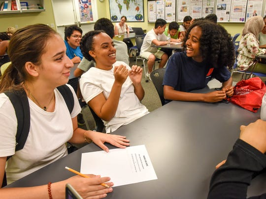 """Annandale High School students practice writing their own fake headlines in a class on """"Fighting Fake News"""" at the Newseum in Washington, D.C."""