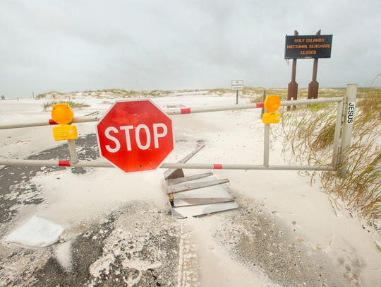 The road at the Gulf Islands National Seashore is covered