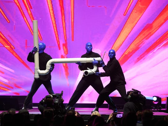 Members of Blue Man Group perform at the Vegas Strong Benefit Concert at T-Mobile Arena to support victims of the October 1 tragedy on the Las Vegas Strip.