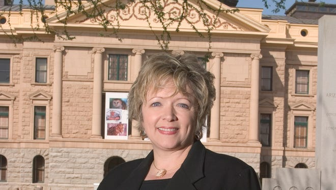 Cathi Herrod, unelected but still in charge of the building behind her.