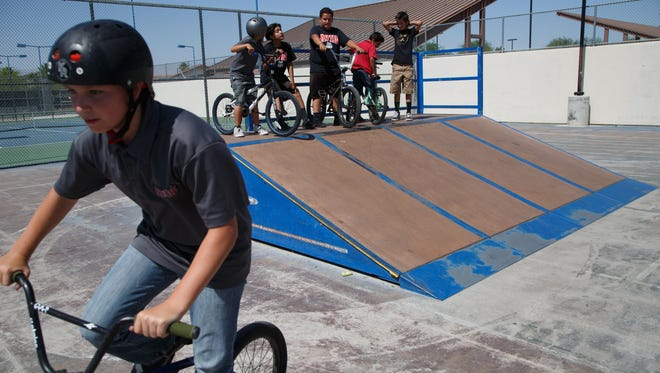 William Anderson, left, rides at the Fritz Burns skate Park in La Quinta with a group of friends after school, Thursday, June 1, 2017.
