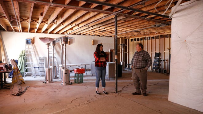 No Worries Sports Bar and Grill General Manager Alycia Raney, left, and Four Corners Regional Airport Manager Mike Lewis talk about the new construction of a new banquet hall, Tuesday, April 24 2018 at No Worries Bar and Grill in Farmington.