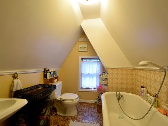 The bathroom has a clawfoot soaking tub