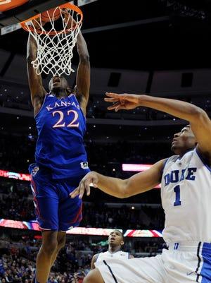 Kansas' Andrew Wiggins dunks on Duke's Jabari Parker.
