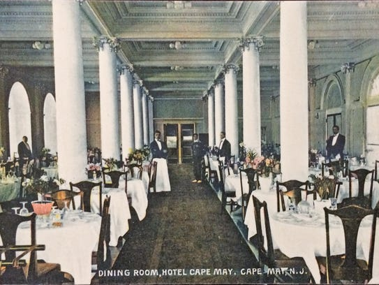 A postcard view of the opulent dining room of the Hotel