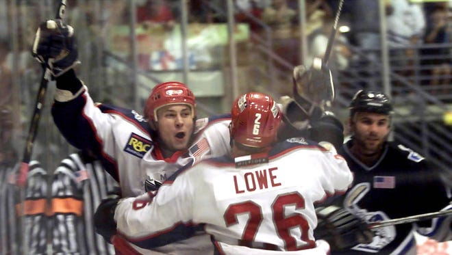 arl Drakensjo and Eddy Lowe celebrate a Jackals goal against the B.C. Icemen during the 2002 playoffs.