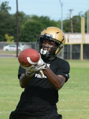 Abilene High running back Niyungeko Moise can't haul