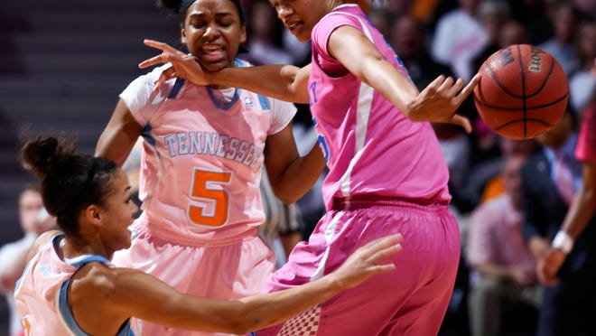 Tennessees' Andraya Carter (14) and Ariel Massengale (5) force a loose ball against Kentucky's Alexis Jennings in the first half Sunday in Knoxville. Tennessees' Andraya Carter (14) and Ariel Massengale (5) force a loose ball against Kentucky's Alexis Jennings in the first half of an NCAA college basketball game, Sunday, Feb. 15, 2015, in Knoxville, Tenn. (AP Photo/Patrick Murphy-Racey)