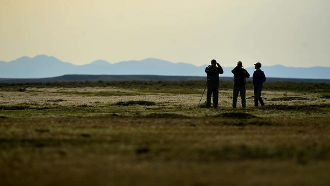 Visitors to the American Prairie Reserve scan the horizon at one of the reserve's prairie dog towns.
