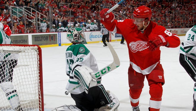 Detroit Red Wings Justin Abdelkader celebrates their first goal to cut the Dallas Stars lead to 2-1 late in the first period in front of Stars' goalie Kari Lehtonen on Sunday, November 8, 2015, in Detroit.