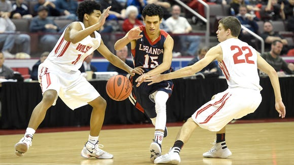 Lebanon Cedar Matthew Lopez pushes past Wilson in the first half of play Saturday morning. Lebanon Cedars fell to Wilson 55-39 at the Giant Center in Hershey, Feb. 20 in the 2016 District III Basketball Championships.