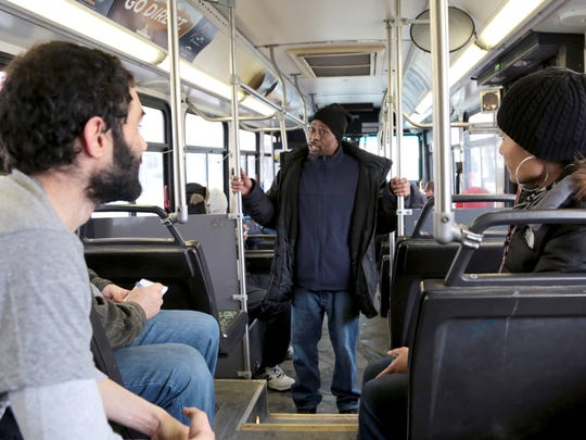 Neil Greenberg, Manager of Service Development and Scheduling for DDOT, listens to Carlton Allen, 50, of Detroit, a lifelong bus rider as he talks about some of the issues he has noticed with some of the bus routes while riding on a DDOT bus on Friday, Feb. 19, 2016.