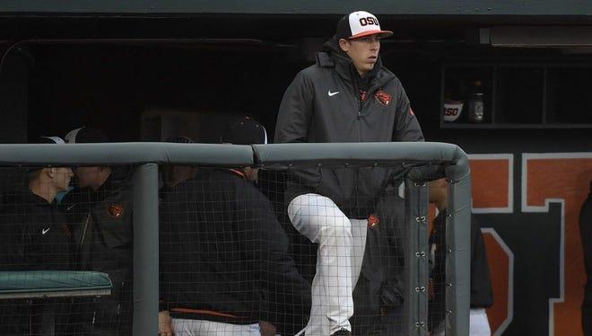 Oregon State's Luke Heimlich watches the team play Vanderbilt during an NCAA college baseball tournament super regional game on June 9.
